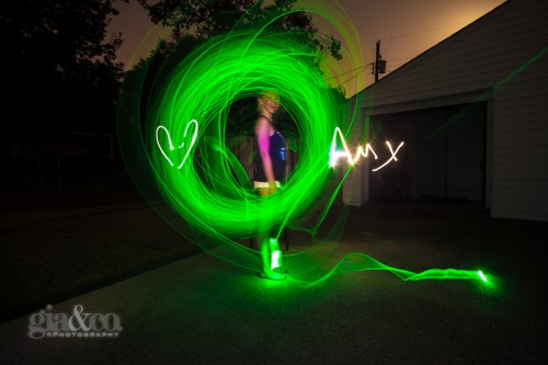 I had the model spin her green glow sticks while I wrote out her name in white light with a heart. Then I stepped out of frame and flashed her face with a white LED flashlight for 3 seconds.