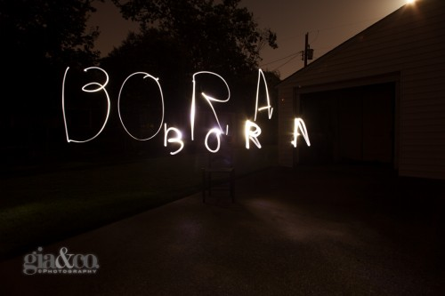 "I also tried writing larger and smaller words at different distances to the camera, which created a more bold print. The larger ""BORA"" was written further away and the letters were written approximately 3 feet in height. The smaller ""BORA"" was written closer to the camera and at 1 foot in height."